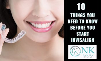 Lady smiling holding invisalign strip